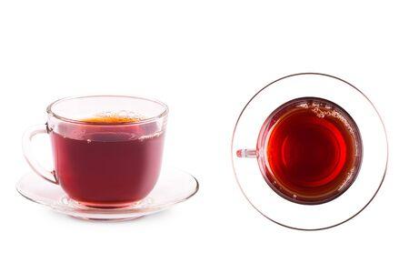 Mug with tea close-up. Glass mug on the saucer.