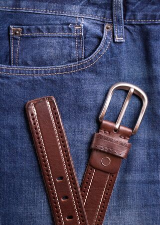 Belt and jeans closeup. Top view on brown belt and blue jeans. Stok Fotoğraf