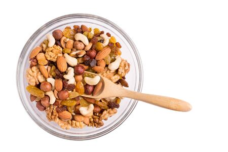 Walnut mix in a plate on a white background.