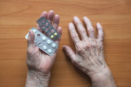Elderly man with medicine in hand. Senior citizen and medicines. Stok Fotoğraf