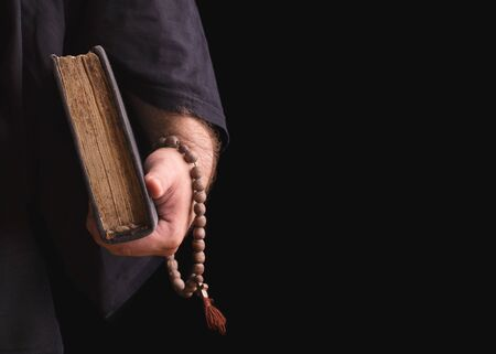 Man with a rosary and a book in hand. Stok Fotoğraf - 128345913