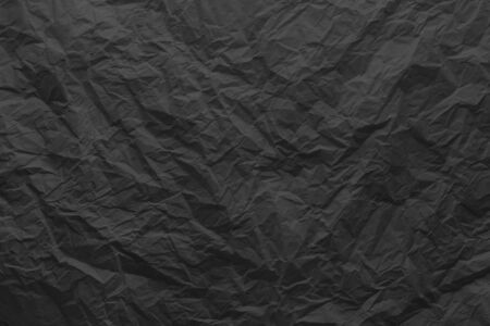 Black crumpled paper close-up. Stok Fotoğraf