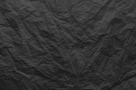 Black crumpled paper close-up. Stok Fotoğraf - 128346237