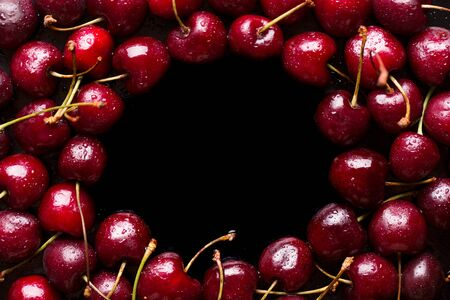 Frame of ripe cherries. Cherry and copy space.