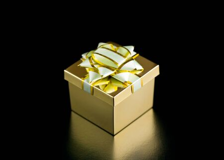 Golden boxing gift close-up.