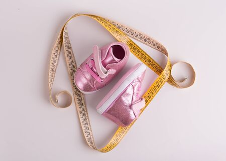 Measurement of children's shoes. Children's shoes. Stok Fotoğraf - 128714359