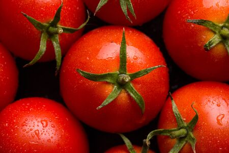 Red tomatoes background. Tomatoes top view. Stok Fotoğraf - 128714453