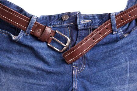 Strap in jeans. Brown belt fitted in blue jeans. Stok Fotoğraf - 128714439