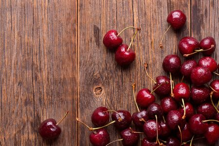 Cherry on a wooden background. Ripe cherry. Stok Fotoğraf