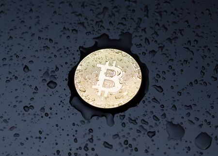 Bitcoin and drops of water. Bitcoin gold coin covered with water drops. Stok Fotoğraf - 128714484