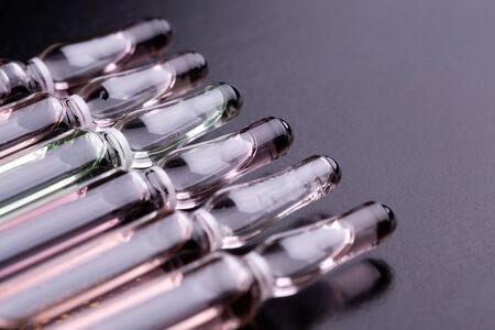 Glass ampoules close up. Standard-Bild