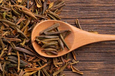 Sagan daila tea leaves close up. Sagan daila tea leaves in a spoon. Shaman tea sagan daila. Archivio Fotografico - 156630211