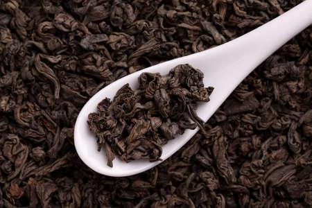 Black tea leaves close up.