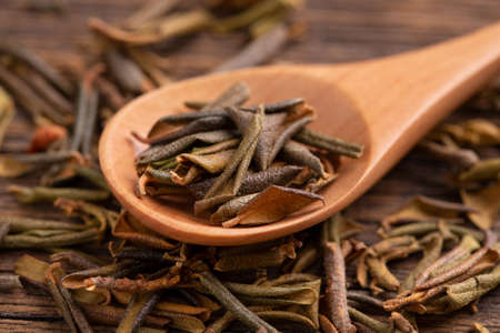 Sagan daila tea leaves close up. Sagan daila tea leaves in a spoon. Shaman tea sagan daila.