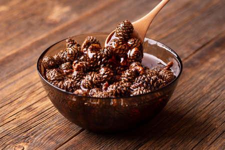Small pine cones in sugar syrup.
