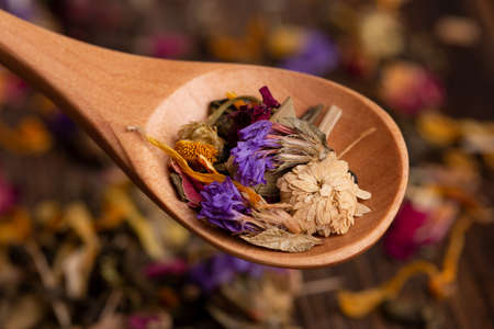 Tea made from dried wildflowers close-up.