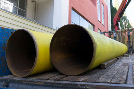 Steel pipes in a truck. Large water pipes close-up.