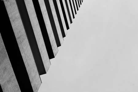 An abstract view looking at a modern concrete building. Artistic view of exterior architectural design and details. A modern building.