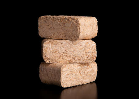 Set of fuel briquettes on a black background. Briquettes for the oven close-up.