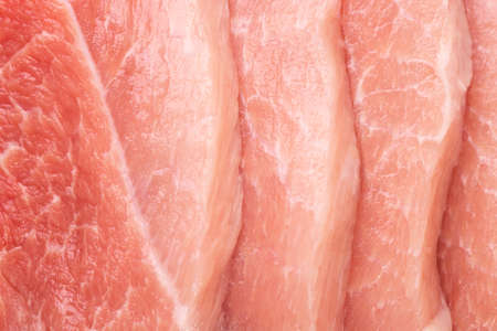 Pieces of sliced raw pork close-up. Pork meat background.