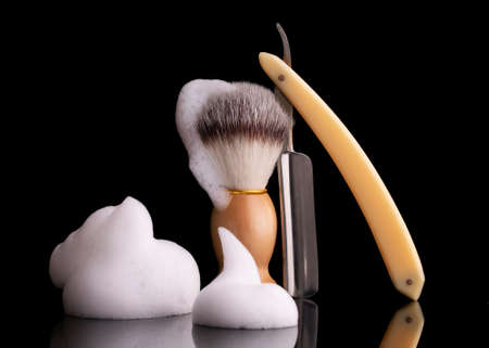 Straight razor and shaving brush on a black background. Archivio Fotografico - 158579387