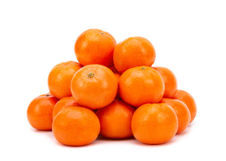 Heap of ripe tangerines on a white background.
