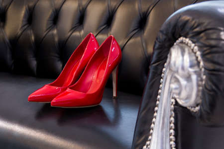 Pair of beautiful red high-heeled shoes. Archivio Fotografico