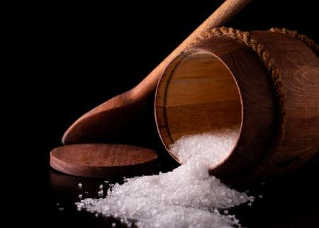 Salt in a barrel close-up.