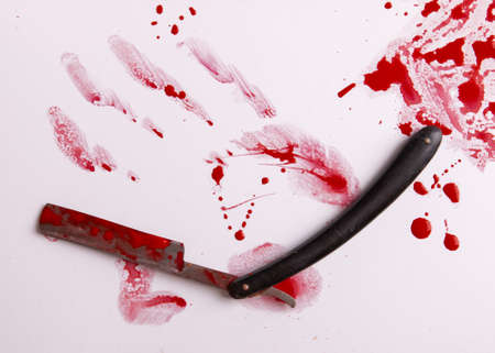 Blood trail and an old straight razor. Blood drops. Murder and suicide concept.