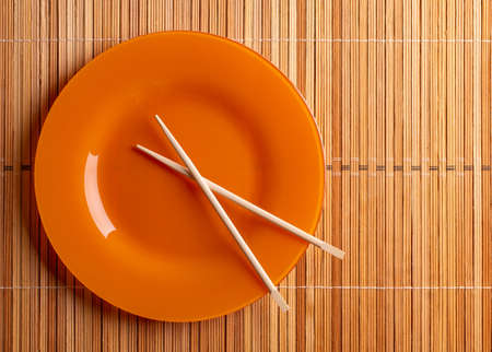 Plate and chopsticks top view.