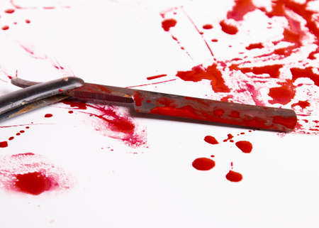 Blood drops. Murder and suicide concept. Blood trail and an old straight razor.