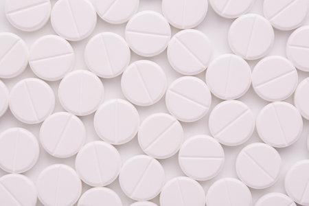 Round white pills background.
