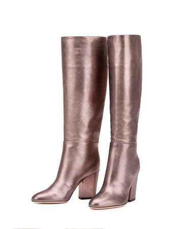 Pair of beautiful leather boots. High-heeled shoes.