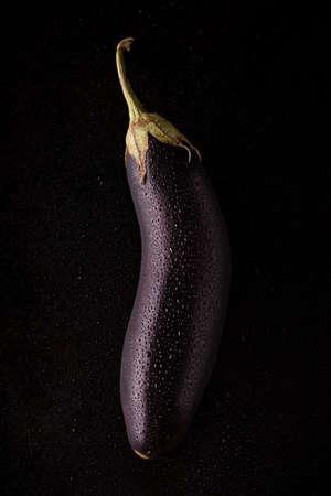 Eggplant on a black background. Фото со стока