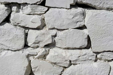 White stone wall texture. Large stone blocks in the wall.