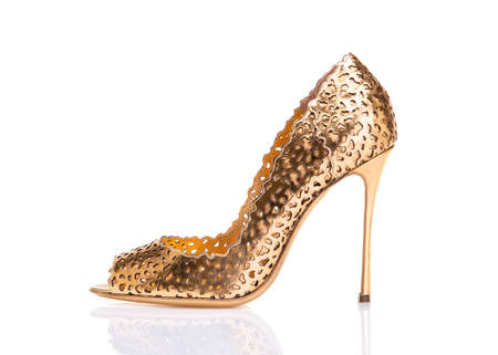 Gold shoes with heels.
