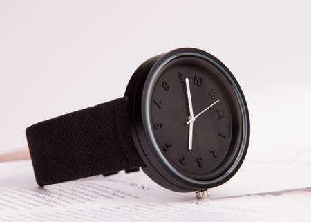 Minimalist wrist watch black dial. Fashionable accessory.
