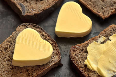 Bread with a heart shaped butter on it photo