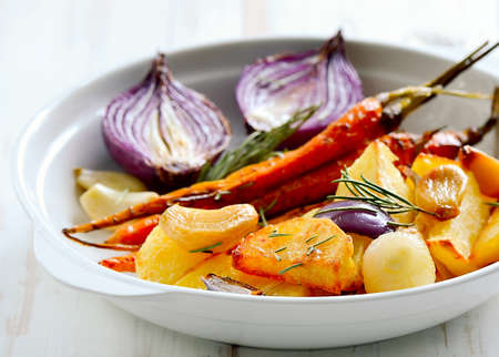 Roasted vegetables in a white plate. Vegeterian dish.