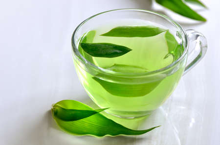 warm drink: Green spa tea in a glass cup, detox and relaxing warm drink