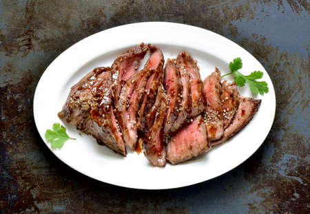 Flank steak in an oval dish, top view