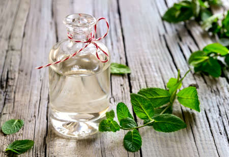 Mint essential oil in a glass bottle
