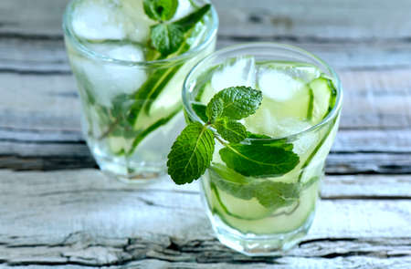 cucumbers: Detox cucumber and mint diet drink, healthy summer cooler Stock Photo