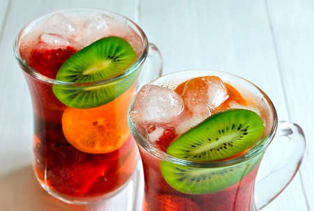 Fruit and berry summer sangria with ice photo