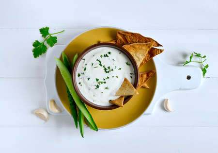 Traditional greek refreshing dip made of yogurt, cucumber and various herbs