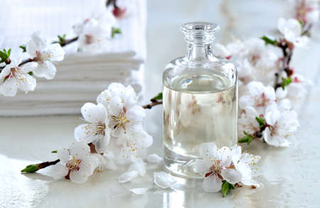 Spa massage oil decorated with spring blooming branches, special formula of essencial oils; exclusive and luxury product