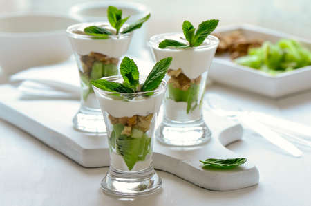 keep fit: Light yogurt parfait with wholenuts kiwi and mint; Healthy cooling breakfast helping to keep fit