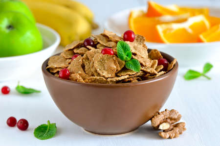 multy: Cereal breakfast with various fruits and berries and wallnuts Stock Photo