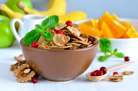 multi grain: Multi grain flakes in a bowl for light healthy breakfast with fruits, berries and nuts