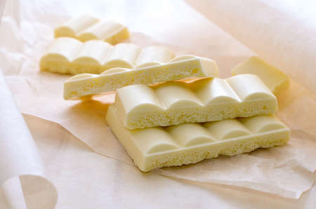 airy: White airy chocolate bars broken and put in a hip Stock Photo